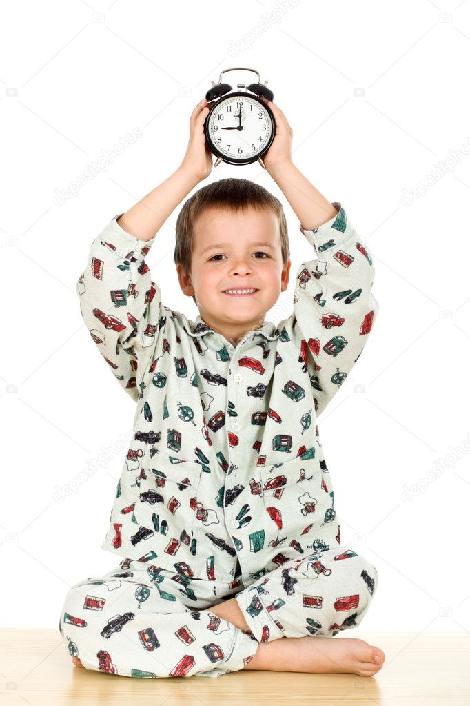 Bedtime concept with happy boy holding an alarm clock - isolated — Stock Photo #6409323