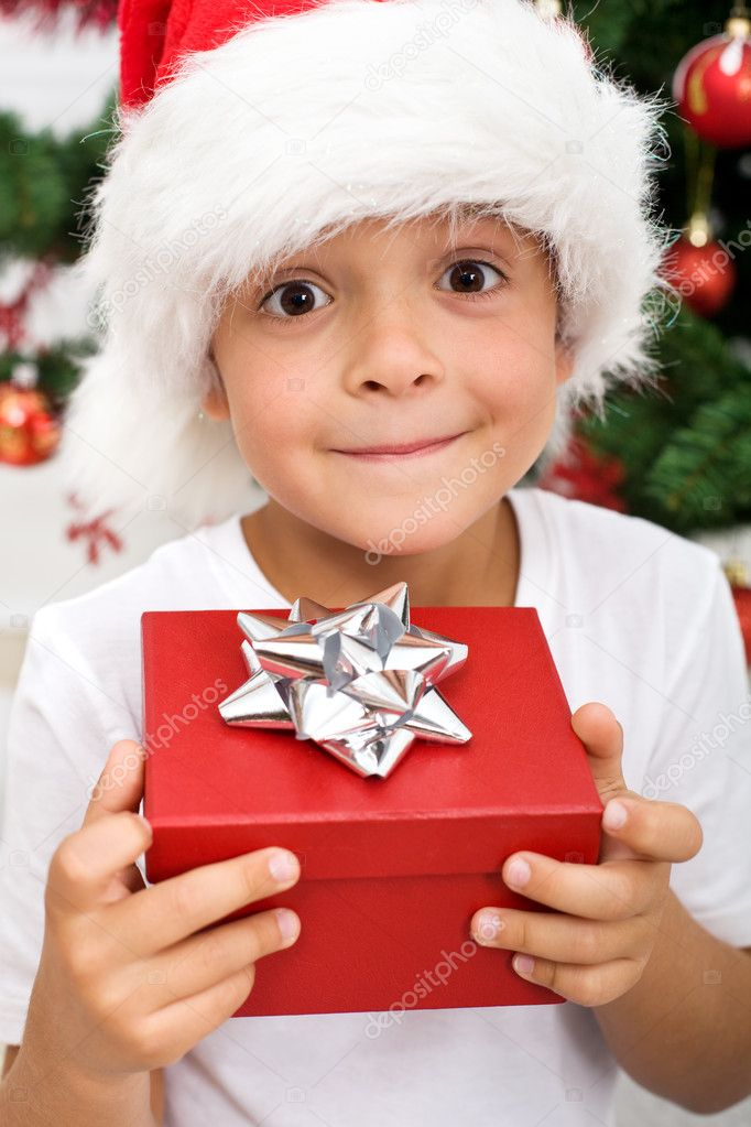Pure happiness - boy with christmas present, closeup — Stock Photo #6409383