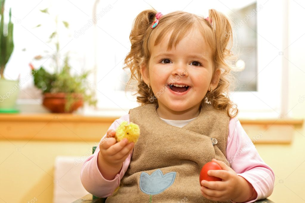 Happy girl with easter egg and decoration in hands — Stock Photo #6409547