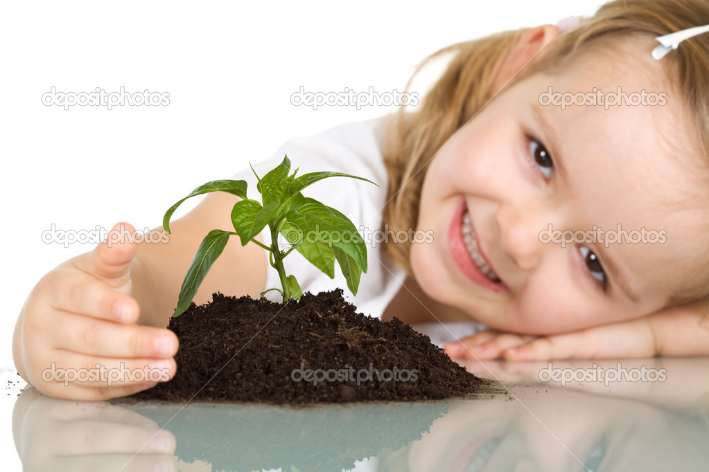 Happy smiling little girl protecting a plant - isolated — Stock Photo #6409698