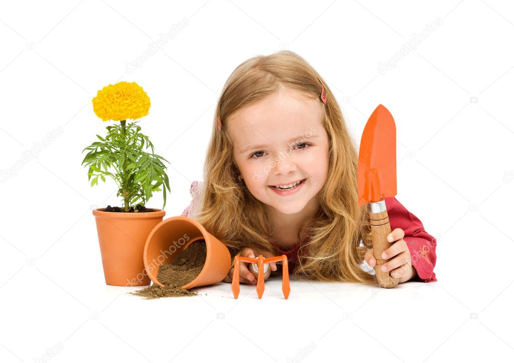 Happy little girl with gardening utensils and potted flower — Stock Photo #6409819