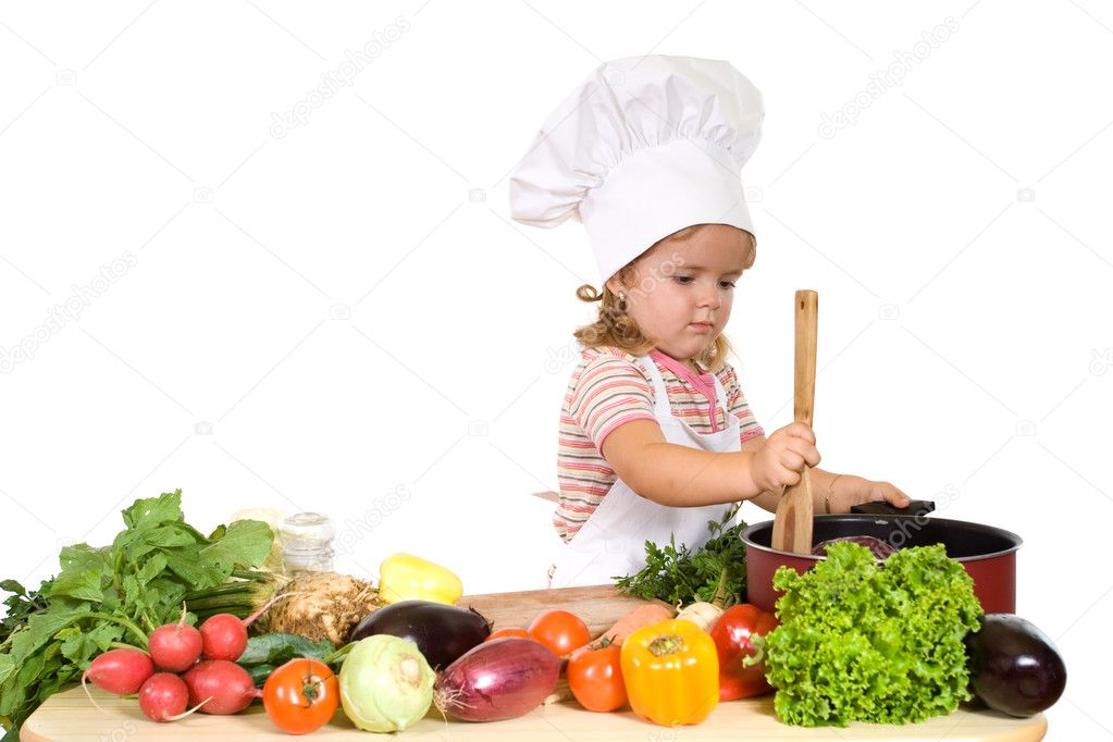 Little chef prepating healthy meal with lots of different vergetables - isolated — Stock Photo #6409822