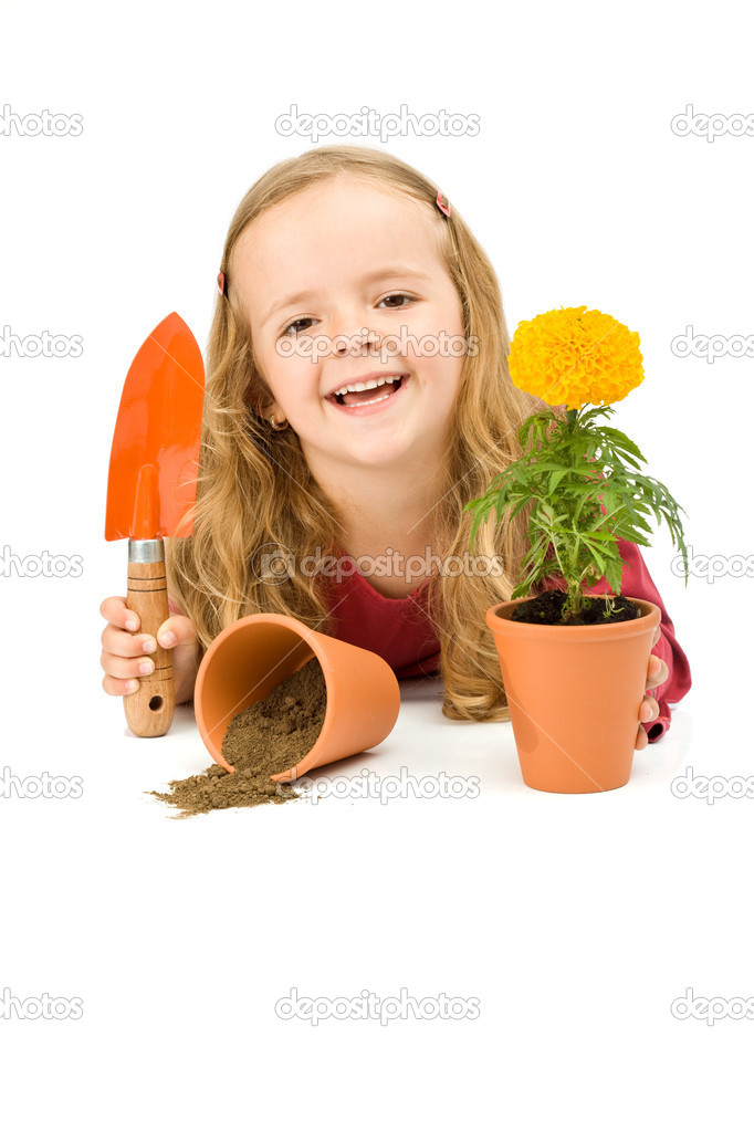 Happy little girl with her potted flower and a gardening spade - isolated — Stock Photo #6409823