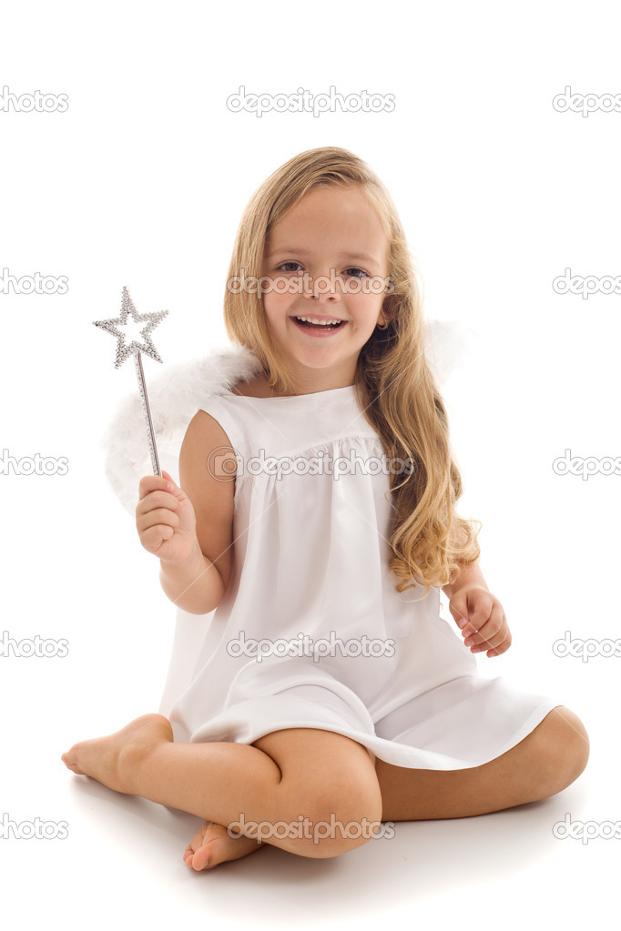 Little happy fairy or angel with magic wand sitting - isolated  Stock Photo #6409952