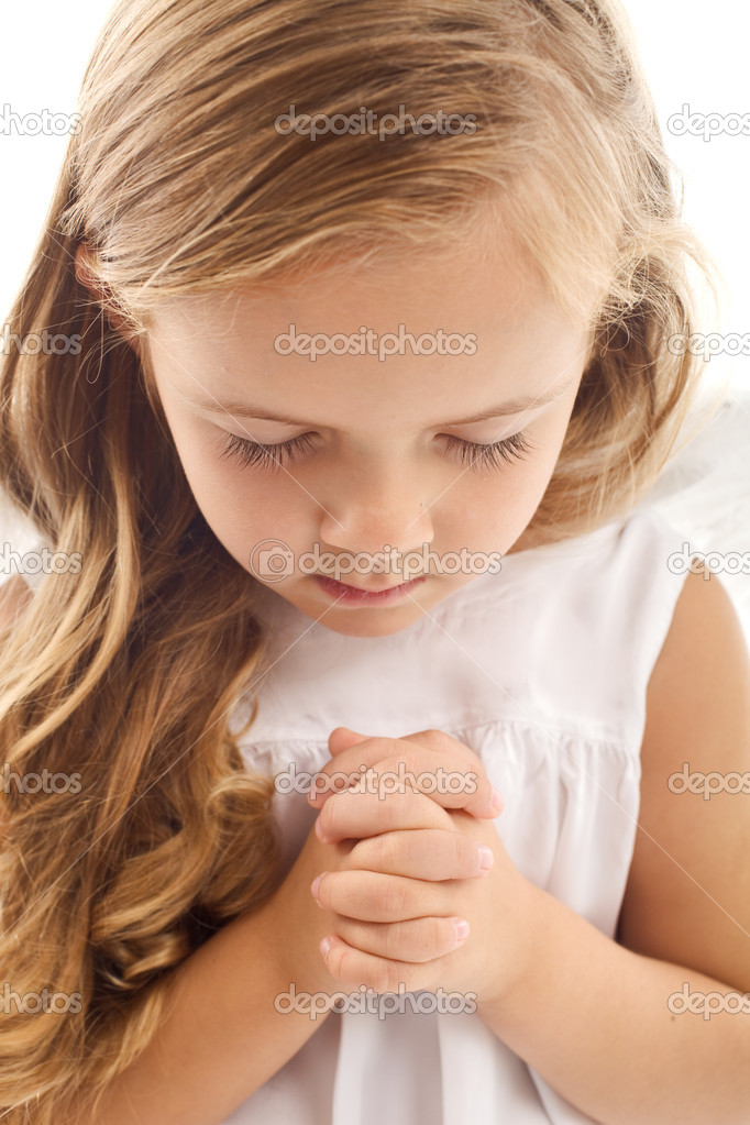 Little girl praying - closeup — Zdjęcie stockowe #6409972