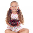 Girl holding a bowl of ripe cherries — Stock fotografie #6410061