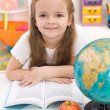 Little girl preparing for school — Stock Photo