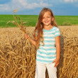 Long golden hair girl in wheat field — Stock Photo