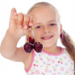 Little girl holding cherries — Stock Photo