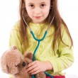 Adorable little girl playing doctor with a teddy bear — Foto Stock