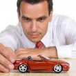 Man with red toy car — Stock Photo #6410217
