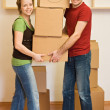 Happy couple moving into a new home — Stock Photo #6410291