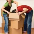 Couple having fun while unpacking in their new home — Stock Photo