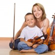 Woman and boy with violins - Stock Photo