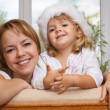 Woman and her little girl at christmas time — Stock Photo #6410655