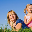 Woman and little girl in the grass — Stock Photo
