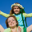 Woman and girl enjoy the spring sun — Stock Photo