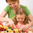 Making fruit salad is healthy and fun — Stock Photo