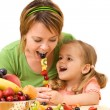 Little girl feeding her mother — Stock Photo #6410751