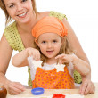 Woman and little girl making cookies — Stock Photo