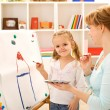 Painting and having fun with mom — Stock Photo