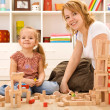Building with wooden blocks — Stockfoto