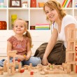 Building with wooden blocks — Stock Photo #6410856