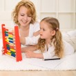 Woman and little girl learning math together — Foto Stock