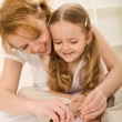 Personal grooming - little girl and her mother cutting nails — Stock Photo