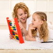 Stock Photo: Doing math exercises with mom