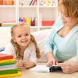 Woman reading to her little girl — Stock Photo