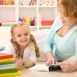 Woman reading to her little girl — Stock Photo #6410922