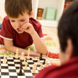 What should I do now - kid playing chess thinking — Stock Photo