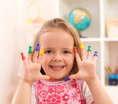 Little girl playing with game pieces — Stock Photo