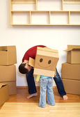 Father and little girl playing with cardboard boxes — Stock Photo