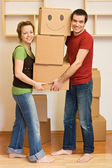 Happy couple moving into a new home — Stock Photo