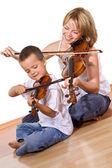 First time practicing the violin — Stock Photo