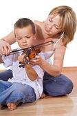 Woman teaching her son — Stock Photo
