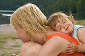 Smeary daughter hugging mother — Stock Photo