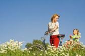 Riding through the daisy field — Stock Photo