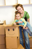 Little girl and woman with cardboard boxes — Stock Photo