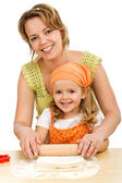 Happy girls stretching the dough — Stock Photo