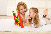 Doing math exercises with mom — Stock Photo