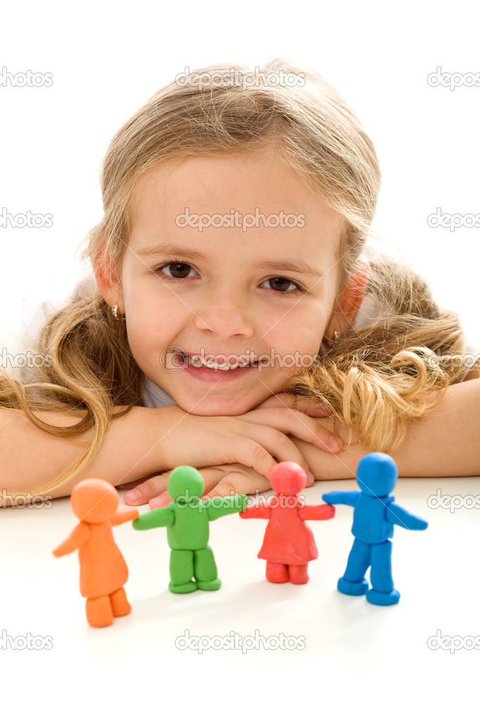 Happy little girl smiling with her colorful clay family - isolated — Stock Photo #6410003