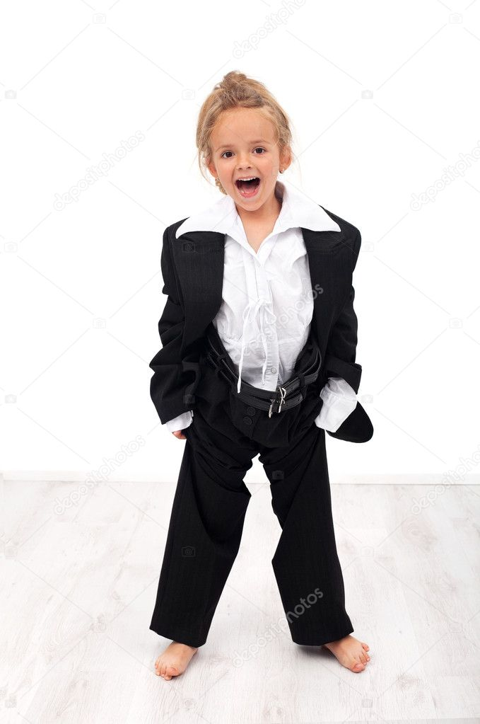 Ecstatic future businesswoman - little girl trying her mother's clothes — Stock Photo #6410045