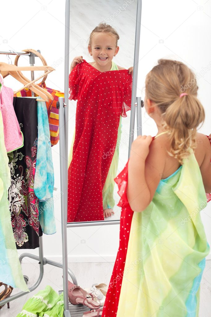 Trying on dresses is fun - little girl in front of the mirror — Stock Photo #6410095