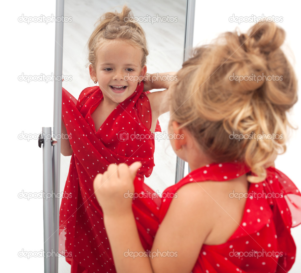 Little girl trying large dress in front of mirror - isolated — Stock Photo #6410097