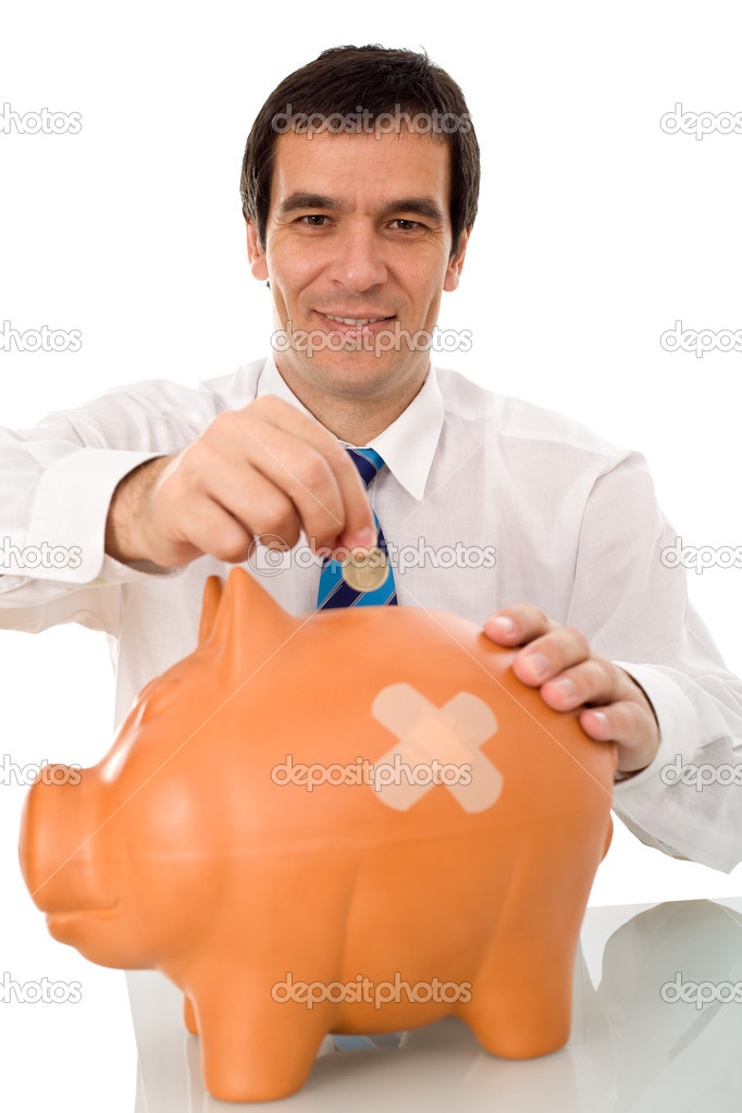Businessman resuming savings with a wounded piggy bank - isolated — Stock Photo #6410250