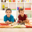 Young kids preparing to play chess — Stock Photo