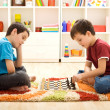 Stock Photo: Let me show you a move - kids playing chess
